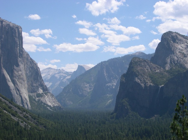 Looking eastward up Yosemite Valley with El Capitan and Bridalveil Falls flanking Half Dome in the distance.